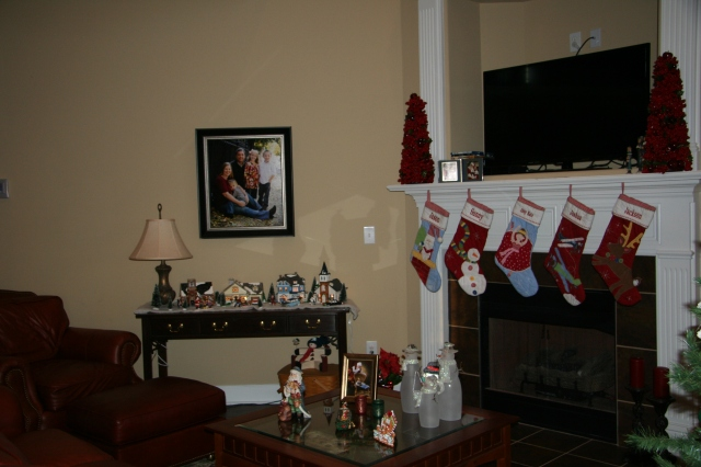 A view of our Christmas village and the stockings.