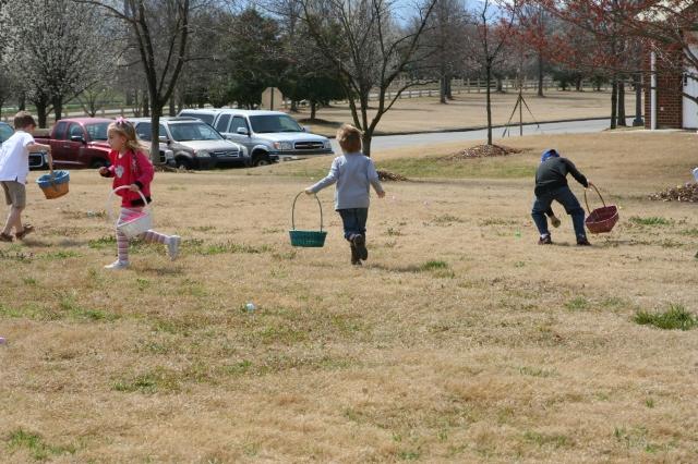 Joshua and Jackson racing to get their eggs.