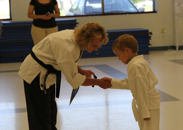 With his instructor, Sensei Mary